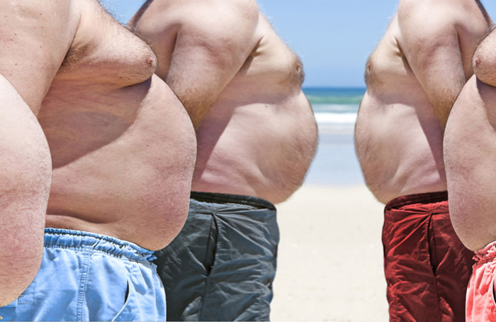 Five obesely fat men on the beach