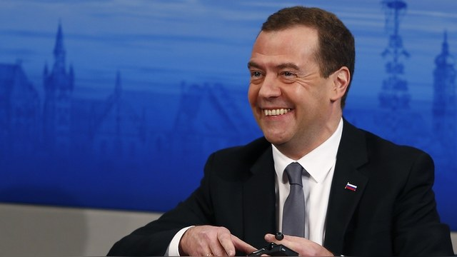 Russian Prime Minister Dmitry Medvedev smiles as he attends at the Munich Security Conference in Munich, Germany, February 13, 2016. REUTERS/Michael Dalder - RTX26QJ3