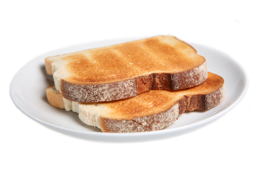 Toasted sliced white bread on white background