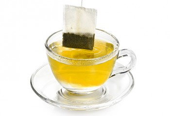tea bag in transparent cup of tea isolated