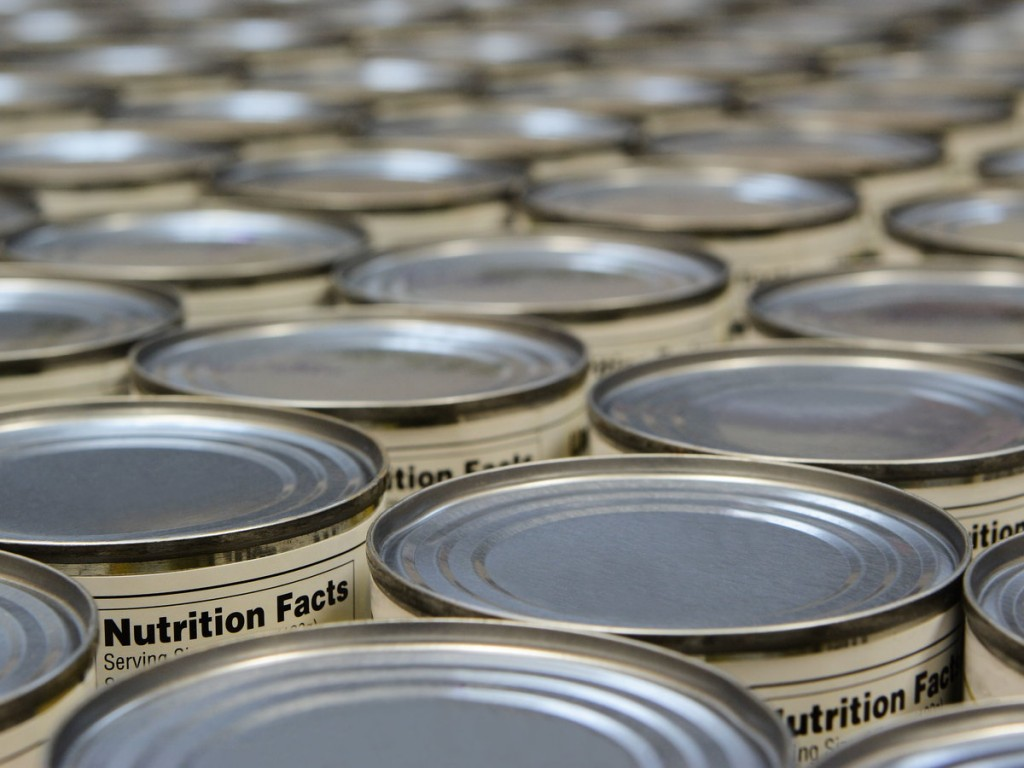 Grocery food cans showing nutrition facts labels.